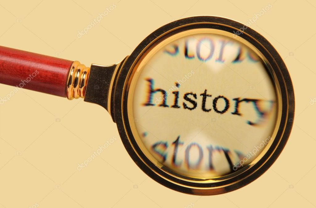 The word history magnified under a magnifying glass.